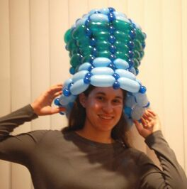 A photo of me wearing a large balloon top hat